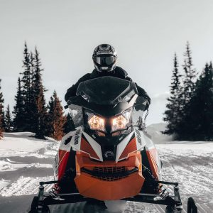 man snowmobiling in Morzine on a piste