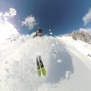 man skiing powder in Morzine