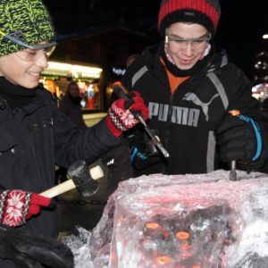 boys chip ice to find treasure during new years week in morzine