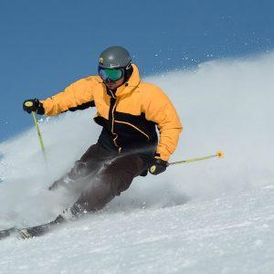 man skiing whilst on luxury ski holiday in Morzine