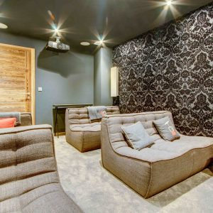 Comfortable chairs in cinema room with projector