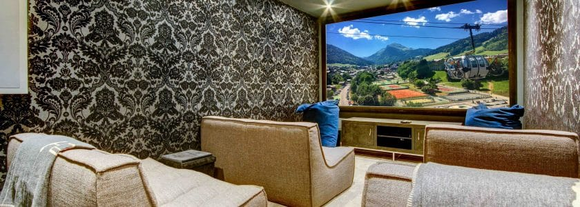 Luxury Cinema room with cosy sofa chairs and a large projector screen